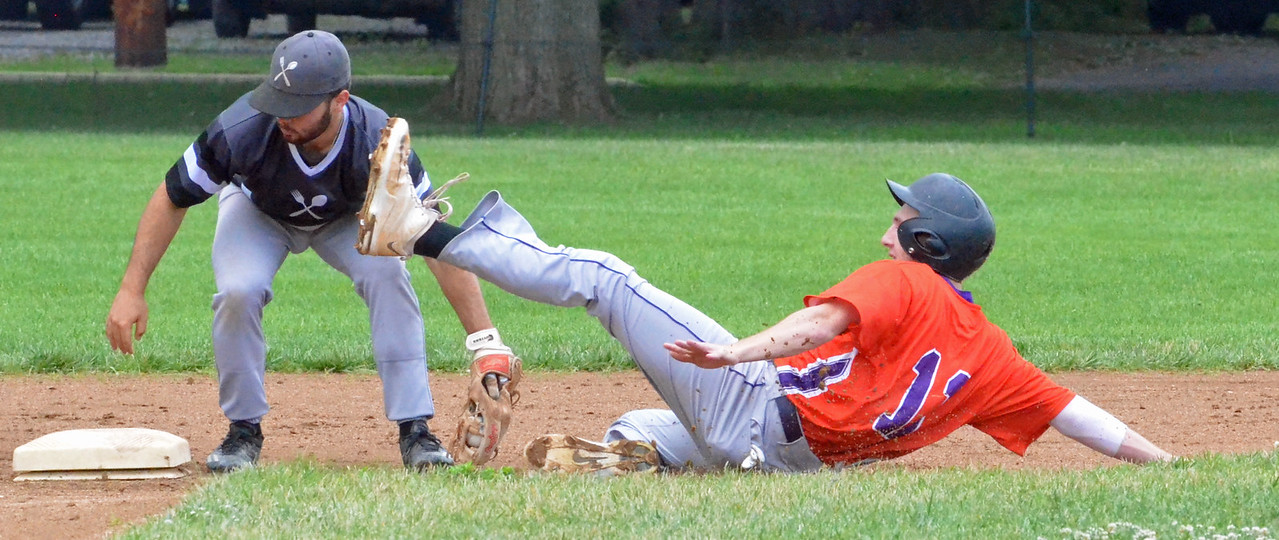 KYLE MENNIG – ONEIDA DAILY DISPATCH Sherrill Silversmiths second baseman Tully Allen (1) puts the tag down on the Cortland Crush's Dylan Ketch (14) during their game in Sherrill on Saturday, July 15, 2017.