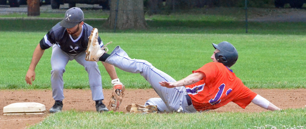 . KYLE MENNIG � ONEIDA DAILY DISPATCH Sherrill Silversmiths second baseman Tully Allen (1) puts the tag down on the Cortland Crush\'s Dylan Ketch (14) during their game in Sherrill on Saturday, July 15, 2017.