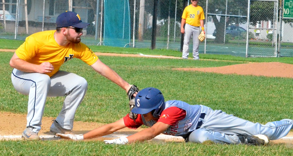 . KYLE MENNIG � ONEIDA DAILY DISPATCH Sherrill Post�s TJ Horodnick (11) is tagged out at third by Ilion Post�s Colin Mayne (7) during the first inning of their game in Sherrill on Sunday, July 16, 2017.