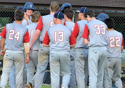 KYLE MENNIG – ONEIDA DAILY DISPATCH Sherrill Post's Andrew Roden (20) is congratulated by teammates after hitting a game-ending home run against Ilion Post during their game in Sherrill on Sunday, July 16, 2017.