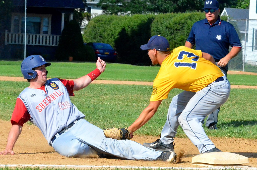 . KYLE MENNIG � ONEIDA DAILY DISPATCH Sherrill Post�s Andrew Roden (20) is tagged out at third by Ilion Post�s Robert Baker (13) during the first inning of their game in Sherrill on Sunday, July 16, 2017.