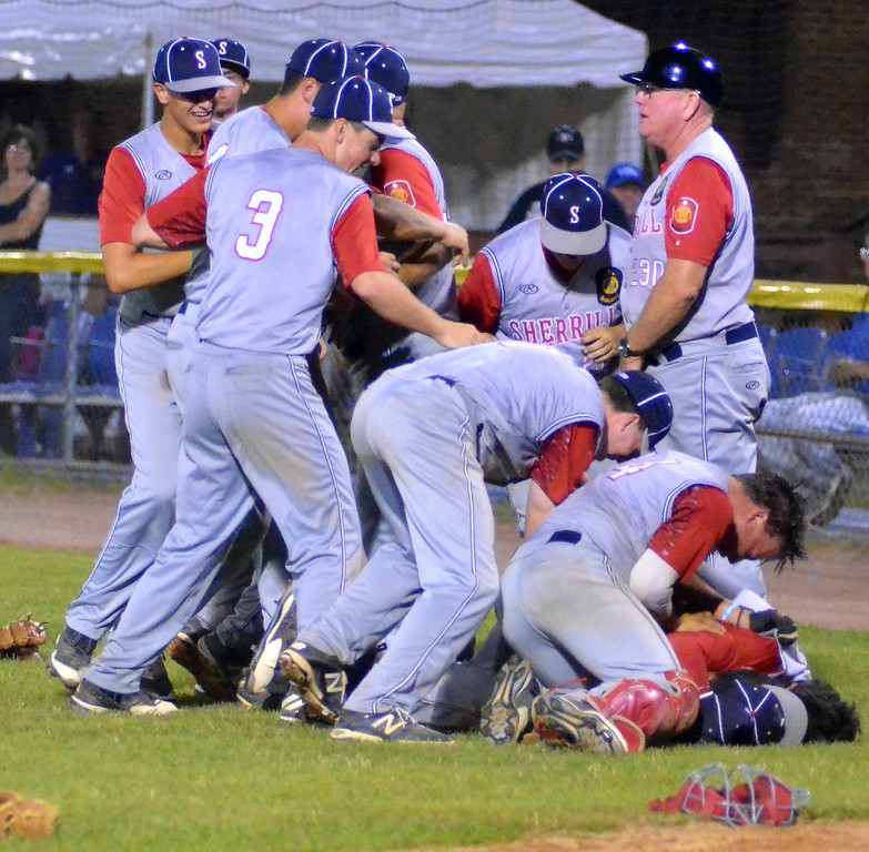 . KYLE MENNIG � ONEIDA DAILY DISPATCH Sherrill Post players celebrate after winning the American Legion Baseball District 5 championship in Utica on Friday, July 21, 2017.