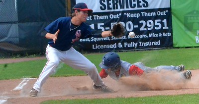 KYLE MENNIG – ONEIDA DAILY DISPATCH Sherrill Post's Nate Palmer (22) dives safely into third as the throw gets away from Utica Post's Brian Wojnas (15).