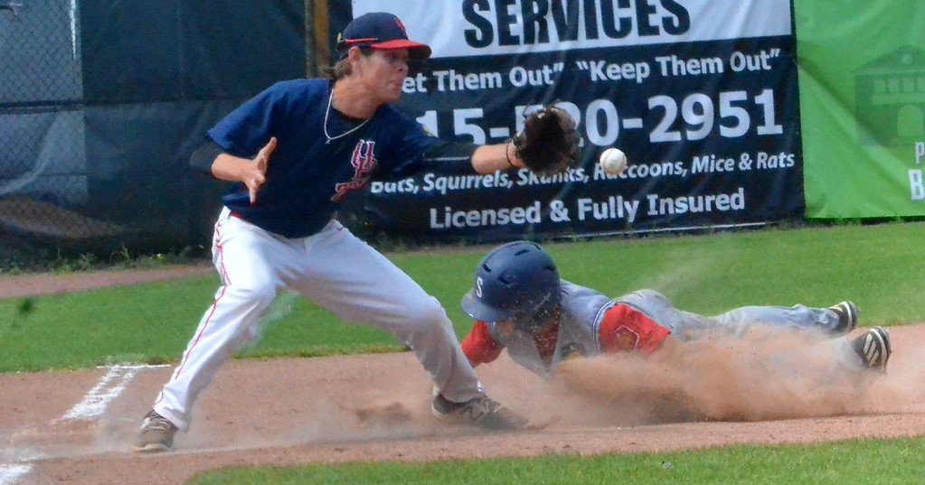 . KYLE MENNIG � ONEIDA DAILY DISPATCH Sherrill Post�s Nate Palmer (22) dives safely into third as the throw gets away from Utica Post�s Brian Wojnas (15).