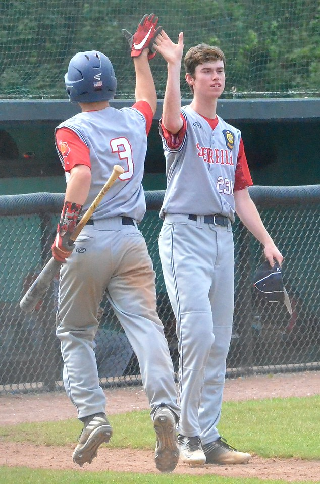KYLE MENNIG - ONEIDA DAILY DISPATCH Sherrill Post's Connor VanDreason, right, congratulates Blake VanDreason after Blake scored a run against Utica Post during their American Legion Baseball District 5 playoff elimination game in Utica on Wednesday, July 19, 2017.