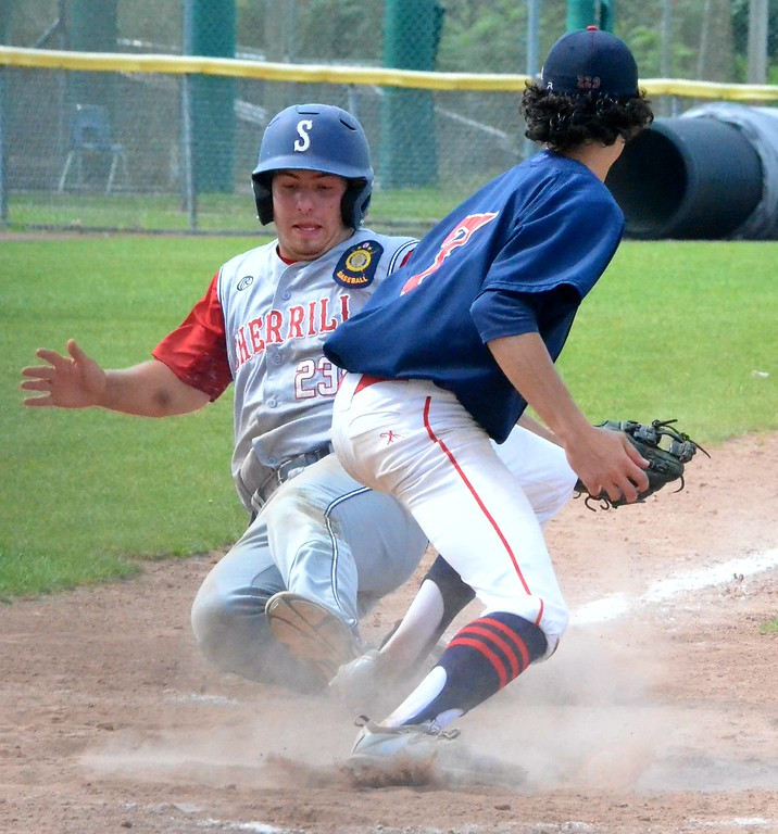 . KYLE MENNIG � ONEIDA DAILY DISPATCH Sherrill Post�s Dylan Shlotzhauer (1) slides safely into home as Utica Post pitcher Josh Raymer (7) covers the plate.