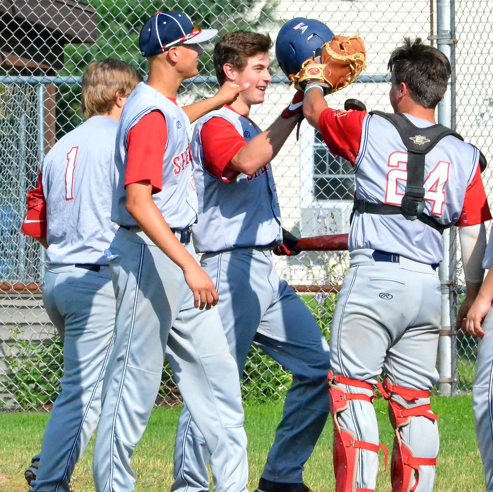 KYLE MENNIG - ONEIDA DAILY DISPATCH Sherrill Post's Blake VanDreason is congratulated by his teammates after hitting a two-run home run in the first inning against Ilion Post during their game in Sherrill on Sunday, July 16, 2017.