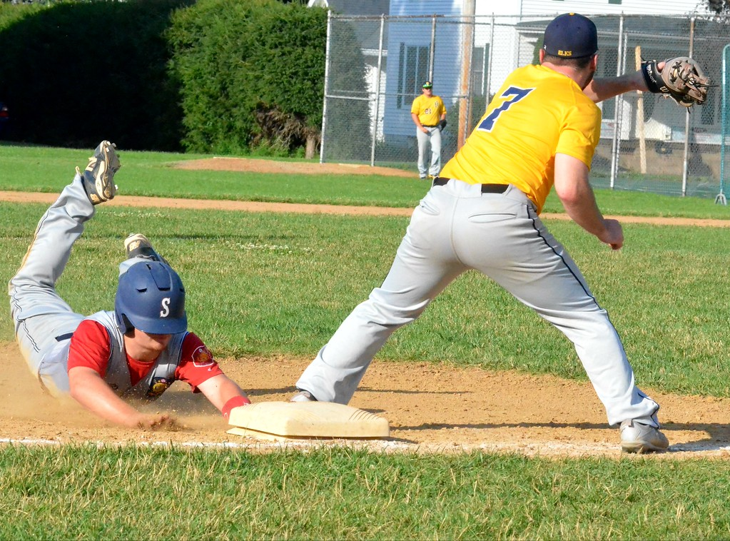 . KYLE MENNIG � ONEIDA DAILY DISPATCH Sherrill Post�s Dylan Shlotzhauer (1) dives safely into third as Ilion Post�s Colin Maine (7) fields the throw during their American Legion Baseball District 5 playoff game in Sherrill on Sunday.