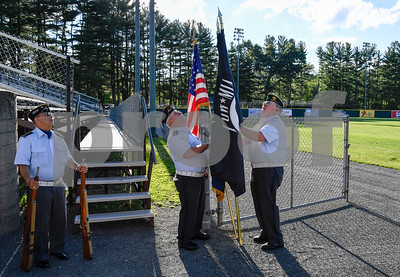 070317  Wesley Bunnell | Staff  The Bristol Blues held military appreciation night at Muzzy Field on Monday evening. Members of the Bristol American Legion Honor Guard prepare for their pregame on field presentation of the flags.