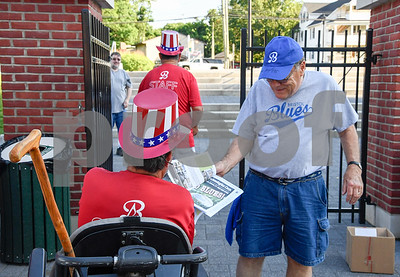 070317  Wesley Bunnell | Staff  The Bristol Blues held military appreciation night at Muzzy Field on Monday evening.  Ray Mertens receives an updated roster from Al Sonier as he enters the gate.