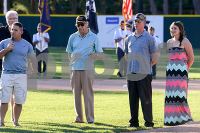 070317  Wesley Bunnell | Staff  The Bristol Blues held military appreciation night at Muzzy Field on Monday evening. Pat Nelligan, left, founder of Veterans Strong in Bristol gives opening remarks as he stands with WWII 3rd Army veteran Bill Grieco and fellow veterans including Nicole Knoll on the right.