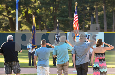 070317  Wesley Bunnell | Staff  The Bristol Blues held military appreciation night at Muzzy Field on Monday evening. Greg O'Brien , left, sings the national anthem as Pat Nelligan, Bill Grieco, and Nicole Knoll , far right, salute.