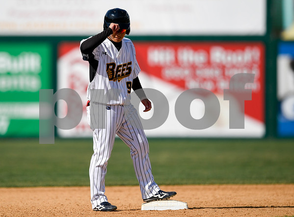 070417 Wesley Bunnell | Staff The New Britain Bees were defeated by the Somerset Patriots on Tuesday afternoon. Tsuyoshi Fujiwara (9) nods towards third base coach Daisuke Yoshida (11) after hitting a two run double which was his first professional hit.