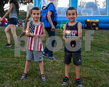 070417  Wesley Bunnell | Staff  4th of July celebrations at Stanley Quarter Park.  Twins Jayden, L, and Joshua Poudrier have fun with sparklers.