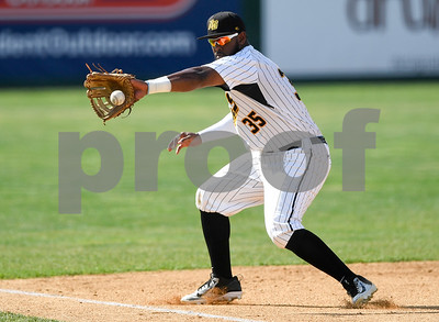 070417  Wesley Bunnell | Staff  The New Britain Bees were defeated by the Somerset Patriots on Tuesday afternoon. Jovan Rosa (35) fields a ball down the line and throws to first for the out.