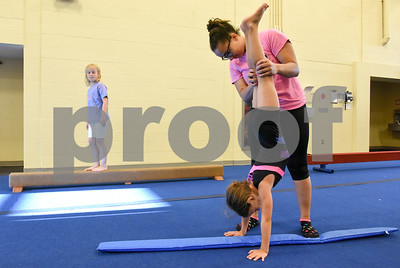 070517  Wesley Bunnell   Staff  Hailie Tedeschi, age 7, receives instruction from Chantel Blake as Keira James, age 6, looks on during gymnastics class on Wednesday afternoon at the YWCA in New Britain.