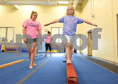 070517  Wesley Bunnell   Staff  Keira James practice on the balance beam with the help from instructor Emily Bonomi during gymnastics class on Wednesday afternoon at the YWCA in New Britain.