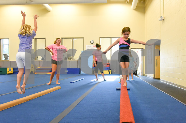 070517 Wesley Bunnell | Staff Taking part in gymnastics class on Wednesday afternoon at the YWCA in New Britain are Keira James, L age 6, instructor Emily Bonomi, instructor Chantel Blake, Hailie Tedeschi, age 7, on the balance beam and Kourtney James, age 7.