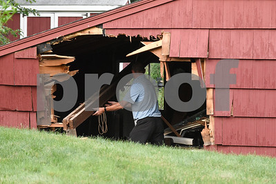 071017  Wesley Bunnell | Staff  124 Indian Hill Rd in Newington where a driver traveling on Oak St veered across the lawn into the side of the garage. A large beam which fell from the ceiling is checked.