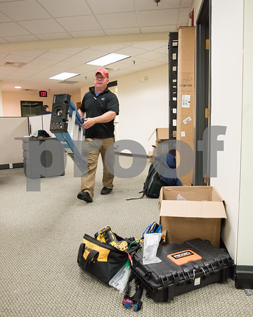 071417 Wesley Bunnell   Staff Sean Reilly of Blue Reserve Water carries a ladder through the new offices of New Britain Herald which is moving to One Liberty Square this weekend.