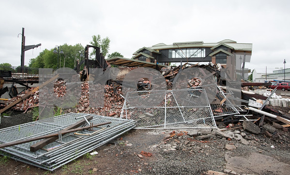 071417 Wesley Bunnell   Staff Piles of bricks from the old Berlin Train Station which was destroyed by fire in December 2016 are shown with the new station in the background.