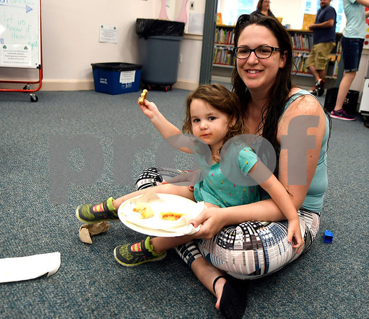 7/14/2017 Mike Orazzi   Staff Chris Carmody and her daughter Claire enjoy pizzza from California Pizza Kitchen at the Bristol Public Library Friday morning.