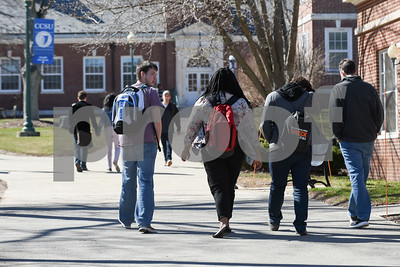 030817  Wesley Bunnell | Staff  Students walk about the CCSU campus on a mild day on March 8.