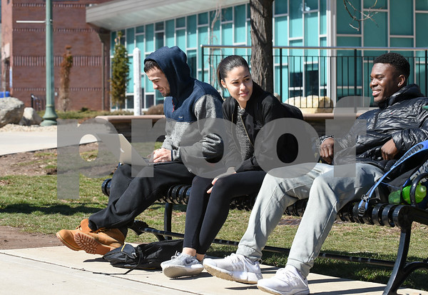 030817 Wesley Bunnell   Staff Students walk about the CCSU campus on a mild day on March 8.