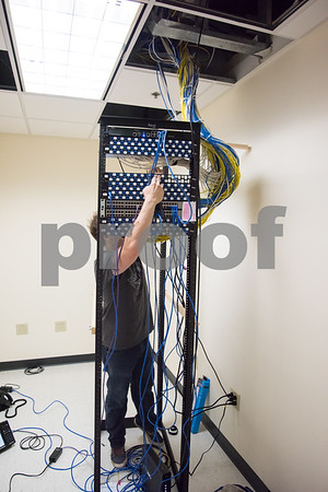 071417 Wesley Bunnell   Staff Adam Sloat from Ed the Phone Guy installs wiring at the New Britain Herald's new location at One Liberty Square.