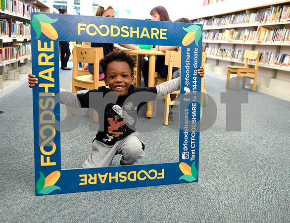 7/14/2017 Mike Orazzi   Staff Jermaine Jenkins while attending a Food Share event at the Bristol Public Library Friday morning.