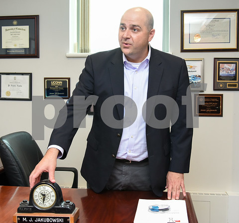 071317 Wesley Bunnell   Staff Incoming President and CEO of Foodshare Jason Jakubowski. Jakubowski discusses the clock given to his grandmother on her retirement from Fafnir Bearings which is featured on his desk.