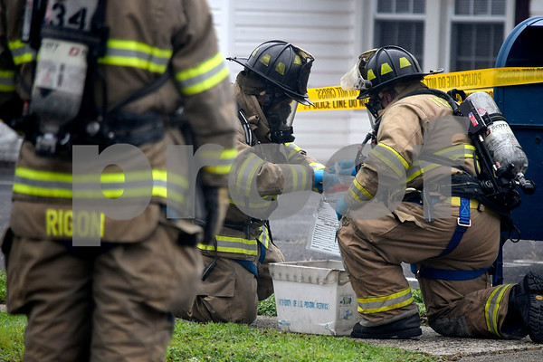 7/14/2017 Mike Orazzi   StaffPlymouth firefighters collect and seal a bag of white powder found in a U.S Postal Service mailbox on Agney Avenue behind Thomaston Savings Bank Friday afternoon. The street was closed for several hours as state DEEP officials, Plymouth Police and Fire along with a regional postal inspector responding to the scene.