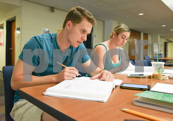 071317 Wesley Bunnell   Staff Erik Kolodziej and Kaitlin Korngiebel study for their Organic Chemistry Class at the CCSU Library on Thursday afternoon.