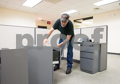 071417  Wesley Bunnell | Staff  Herald employee Larry Rashaw assembles cabinets at One Liberty Square in preparation of this weekends move by the New Britain Herald.