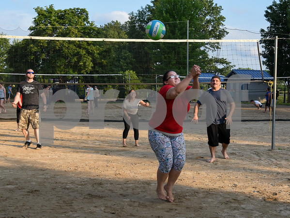 071717 Wesley Bunnell | Staff Cassandra Roa with a return shot in a game of sand volleyball at Casey Field in Bristol on Monday evening in the background are Brandon Howard, L, Alexandra Rodriguez and Julio Aponte.