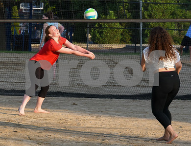 071717  Wesley Bunnell   Staff  Shannon McEnerney, L, returns a shot along with teammate Alexandra Rodriguez in a game of sand volleyball at Casey Field in Bristol on Monday evening.