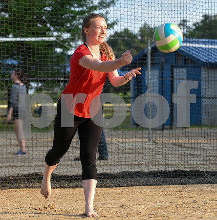 071717 Wesley Bunnell | Staff Shannon McEnerney serves in a game of sand volleyball at Casey Field in Bristol on Monday evening.