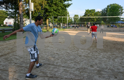 071717  Wesley Bunnell   Staff  Carlos Rodriguez prepares to serve in a game of sand volleyball at Casey Field in Bristol on Monday evening.