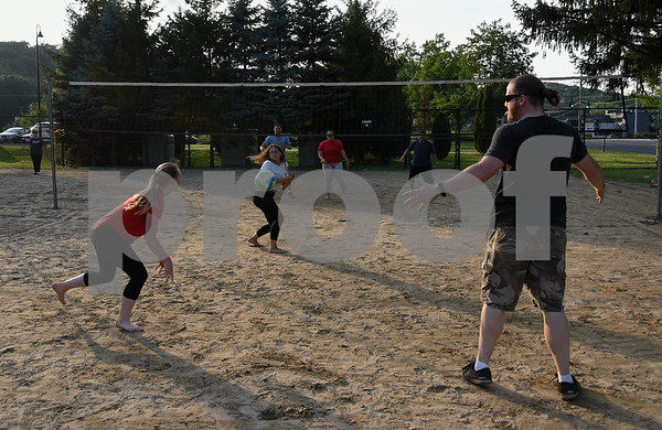 071717 Wesley Bunnell | Staff Teammates Shannon McEnerney, L, Alexandra Rodriguez and Brandon Howard react to the ball in a game of sand volleyball at Casey Field in Bristol on Monday evening against Carlos Rodriguez, L, Cassandra Roa and Julio Aponte across the net.