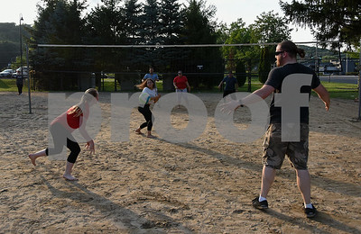 071717  Wesley Bunnell   Staff  Teammates Shannon McEnerney, L, Alexandra Rodriguez and Brandon Howard react to the ball in a game of sand volleyball at Casey Field in Bristol on Monday evening against Carlos Rodriguez, L, Cassandra Roa and Julio Aponte across the net.
