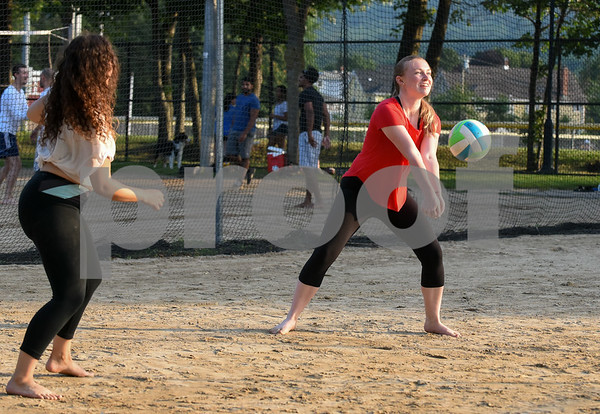 071717 Wesley Bunnell | Staff Alexandra Rodriguez, L, looks on as teammate Shannon McEnerney returns a volley in a game of sand volleyball at Casey Field in Bristol on Monday evening.
