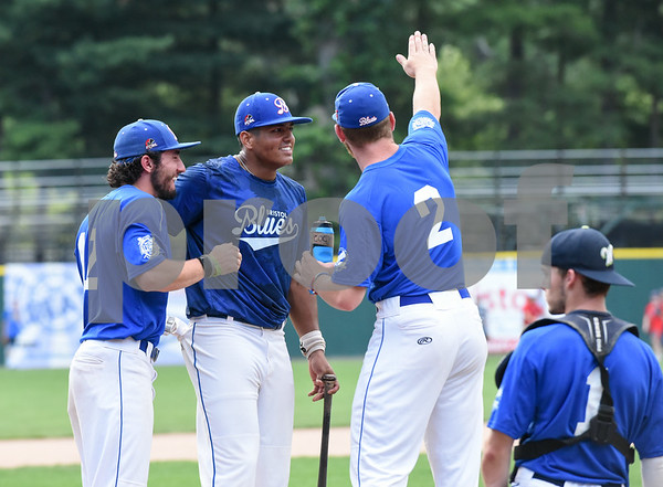 071817 Wesley Bunnell   Staff Jayson Gonzalez (40), middle, of the Bristol Blues gets a pep talk during the home run derby at the FCBL All Star Game at Muzzy Field on Tuesday night. Gonzalez would go on to win the home run derby.