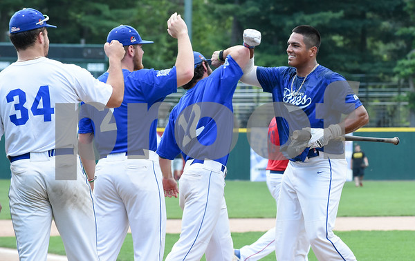 071817 Wesley Bunnell   Staff Jayson Gonzalez (40), R, of the Bristol Blues is congratulated by teammates after winning the home run derby at the FCBL All Star Game at Muzzy Field on Tuesday night.