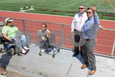 071817  Wesley Bunnell | Staff  City officials gave a tour of Veterans' Stadium in New Britain which recently underwent renovations per ADA guidelines. Brenda Socha, L and Antonio Orriola listen as parks and recreation's Craig Bowman, far right, explains improvements made to the grandstand.