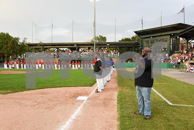 071817  Wesley Bunnell | Staff  The FCBL held their All Star Game on Tuesday evening at Muzzy Field which was preceded by a fan fest and workout by players for area scouts. Players line the field during the National Anthem which was sung by Angelo Wilkes.