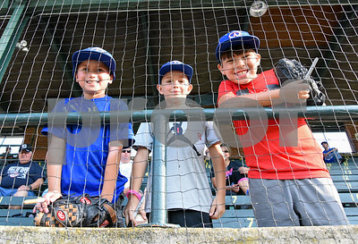 071817  Wesley Bunnell | Staff  Nine year old Cole Chaivanik, L, Ayden Rosario, age 8, and Landon Gawel, age 9, look for autographs at the fan fest prior the FCBL All Star Game played at Muzzy Field on Tuesday evening.
