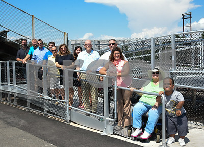 071817  Wesley Bunnell | Staff  City officials gave a tour of Veterans' Stadium in New Britain which recently underwent renovations per ADA guidelines. Posing on the newly installed ramp to the grandstand is Mayor Erin Stewart along with Brenda Socha and Antonio Orriola to her right as well as other city officials.