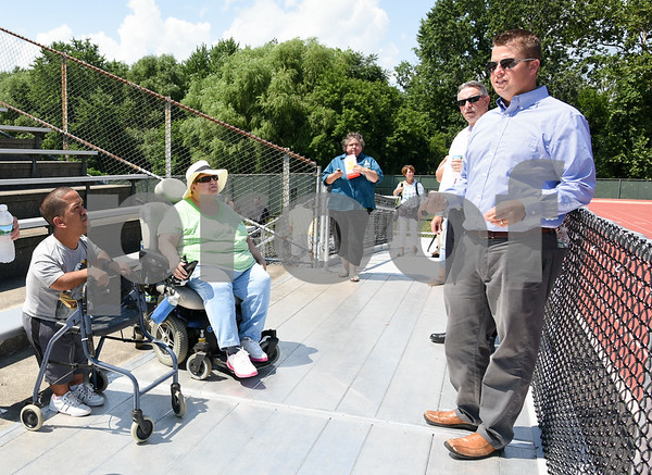 071817 Wesley Bunnell   Staff City officials gave a tour of Veterans' Stadium in New Britain which recently underwent renovations per ADA guidelines. Antonio Orriola, L, and Brenda Socha listen as parks and recreation's Craig Bowman explains improvements made to the grandstand.