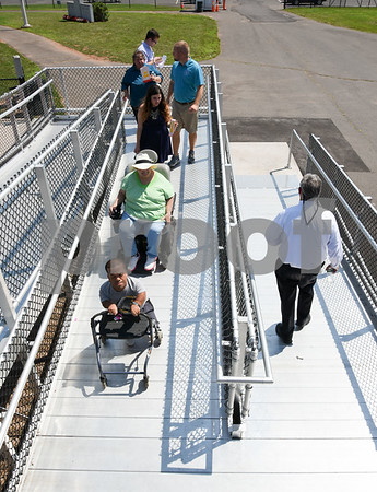 071817 Wesley Bunnell   Staff City officials gave a tour of Veterans' Stadium in New Britain which recently underwent renovations per ADA guidelines. Antonio Orriola, L, and Brenda Socha exit the grandstand via the newly installed ramp.