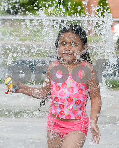 072017  Wesley Bunnell | Staff  Janiah Calcano, age 4, runs through a sprinkler at the Chesley Park Splash Pad on Thursday afternoon.